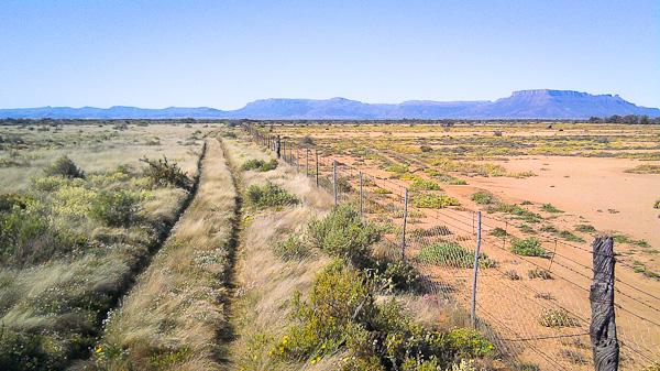 ambos lados de la valla en sudáfrica